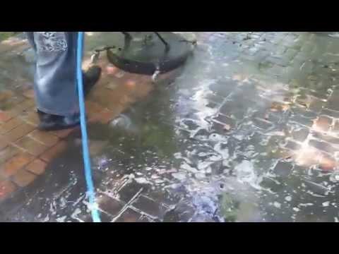 Washing brick pavers