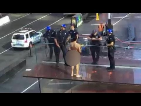 Naked man in standoff with police in Times Square