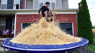 5 MILLION PIECES OF POPCORN ON TRAMPOLINE!