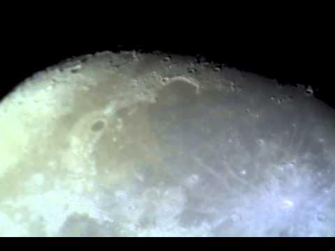 home made amteur 16 inch newtonian reflector telescope captures crators of moon by telescope