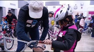 Kids line up for free bikes