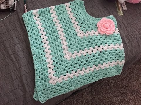 CROCHET PONCHO WITH FLOWER