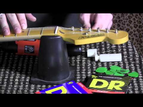How to restring your Stratocaster guitar with open slot vintage style tuners