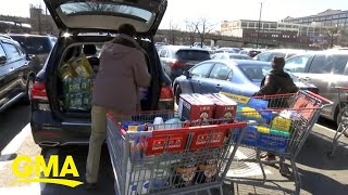 Woman helps elderly couple concerned about going into grocery store | GMA