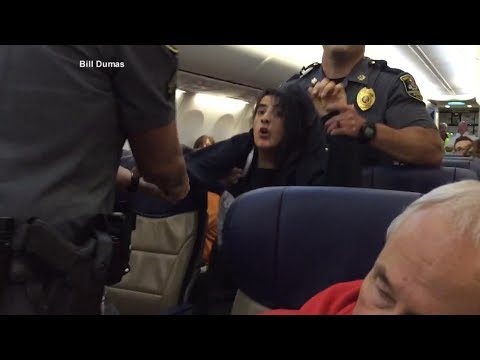Woman dragged off of Southwest Airlines flight speaks out