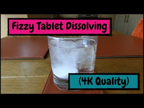Fizzy Tablet Dissolving in Water 4K Quality