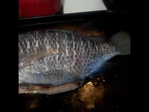 A whole stuffed tilapia fish