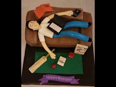 Lazy guy sofa fondant cake