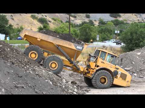 Volvo Dump Truck driving and dumping