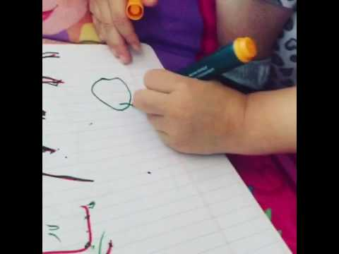 Toddler writing her name learning time