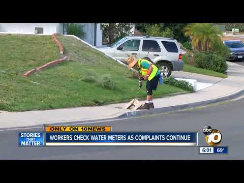 Workers check water meters as complaints continue