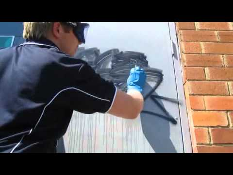 Removing spray paint from a painted door with SoSafeUSA.com