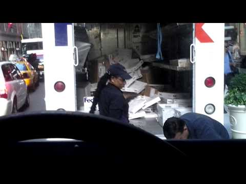 FedEx employee throwing items in truck