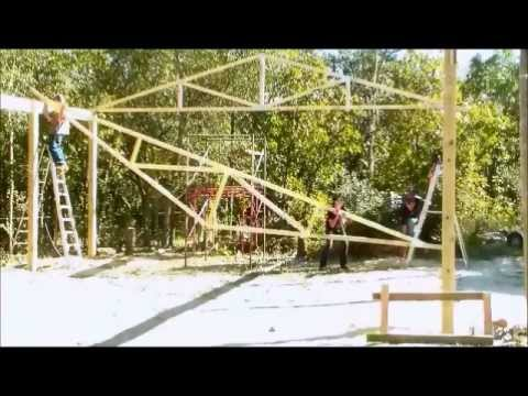 Raising and setting wood trusses.- Wood truss building construction.