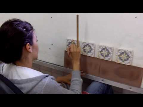 Hand painting Spanish Tile near Sevilla, Spain