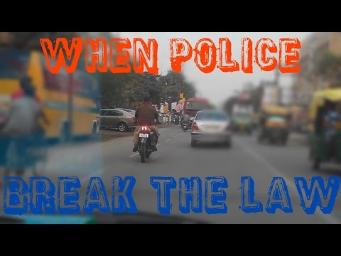 When Police Breaks the Law . Riding without a Helmet