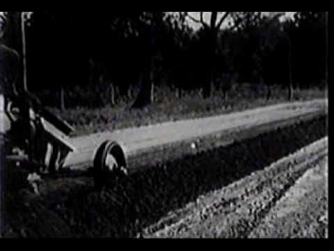 Bitumous treatment of gravel roads.avi