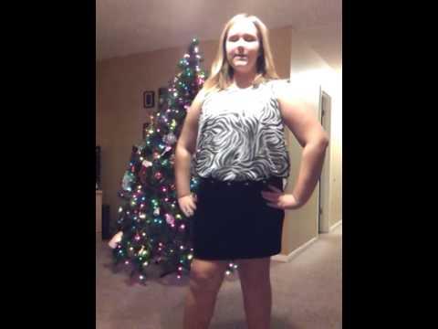 Nerd girl models her new Christmas dress.