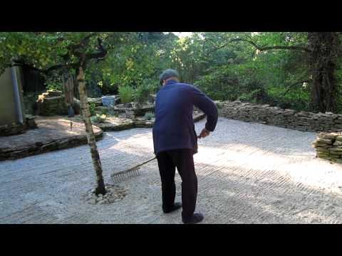 Jikosan raking the Zen garden. Scots Farm