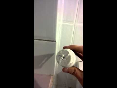 How to clean the grout in between white bathroom tiles