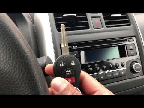 Lock door, unlock door, open trunk, panic button all on the key  - NISSAN VERSA - HOW TO