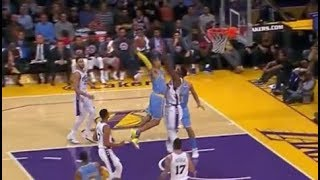 Kyle Kuzma almost destroys Joel Embiid with dunk, Embiid laughs