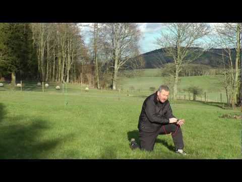 Taking a compass bearing from a landscape feature