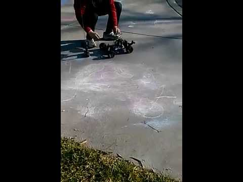 toy car almost gets wiped out by car