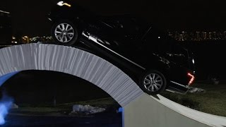 Car Drives Over Bridge Made of Paper