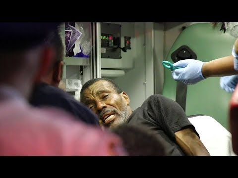 Crown Heights man shot, screaming in ambulance.
