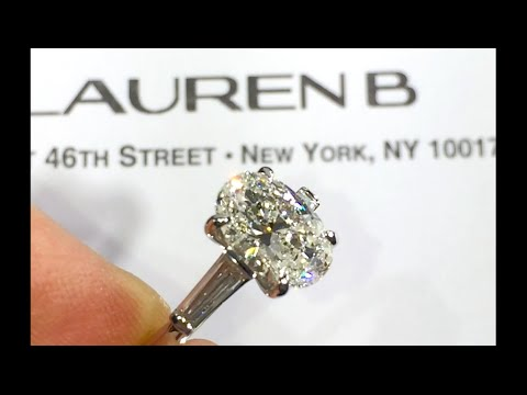2 ct Oval Dimond Engagement Ring with Two Baguette Side Stones