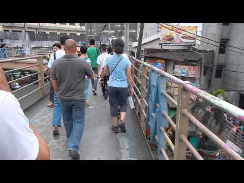 Leaving EDSA LRT Station, Manila