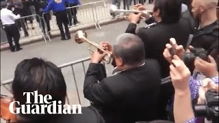 Mariachi band performs as part of protest outside Aaron Schlossberg