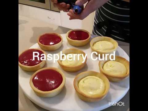 Zesty orange custard and raspberry curd meringue tarts