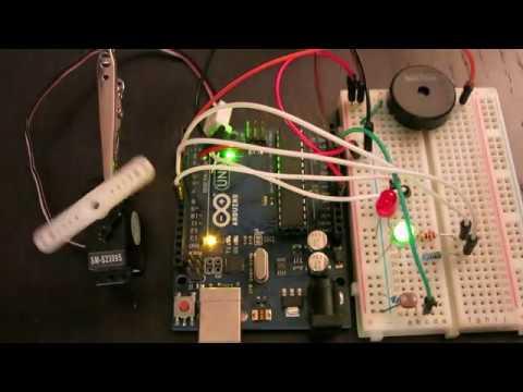 Light-Sensitive Servo Movement with Sound and Lights