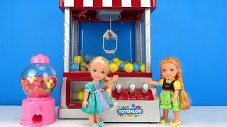 Claw Machine ! Elsa and Anna toddlers win prizes - Arcade game room