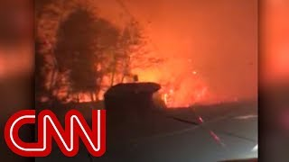 Dad sings to young daughter while driving through wildfire