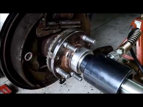 Symptoms of a bad wheel bearing on car (Subaru) and changing it (pressed in)
