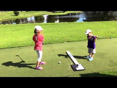 Both Kids Hit Golf Balls
