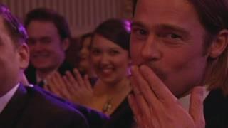 Stephen Fry makes Brad Pitt air kiss the TV audience at the BAFTAs