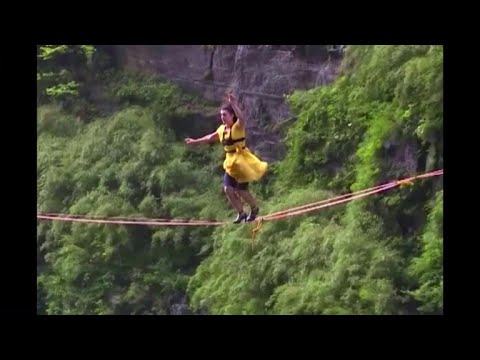 Women walk tightrope more than 4,000 feet above ground in high heels