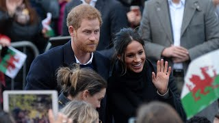 Meghan and Harry greeted by crowds at Cardiff castle