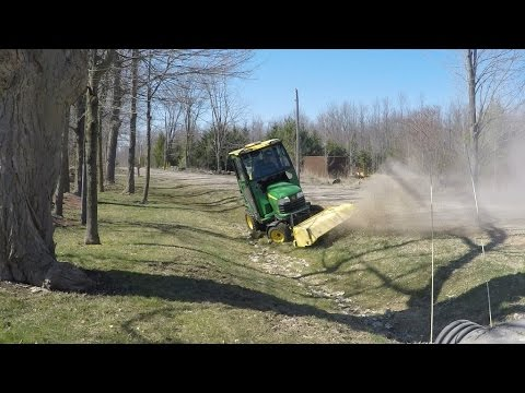 John Deere X748 and 51 Broom  - Sweeping the gravel out of the Ditch - 20160417