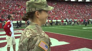 Army Captain surprises daughter at Wisconsin Football Game