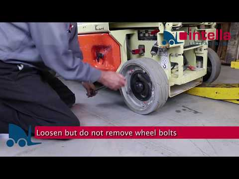 How to replace a scissor lift tire