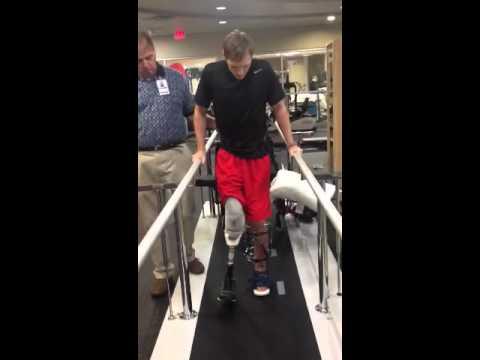 Eric's first steps to walking!!! Parallel Bars! http://www.facebook.com/PrayersForEricHunter?ref=hl#