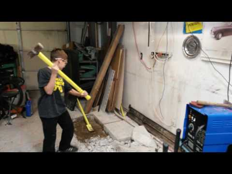 Oscar learning how to use a sledgehammer - breaking up concrete