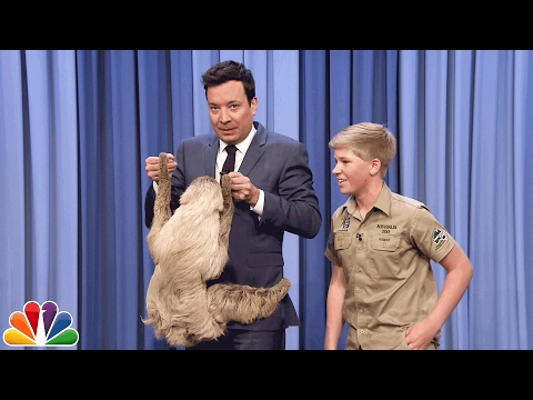 Robert Irwin and Jimmy Cuddle a Sloth
