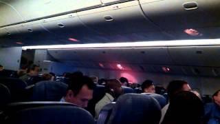 A man being removed from Delta Airlines DL284 from Narita, Japan to Los Angeles 3-30-13