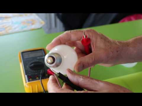 How to test a light bulb for continuity with a multimeter.